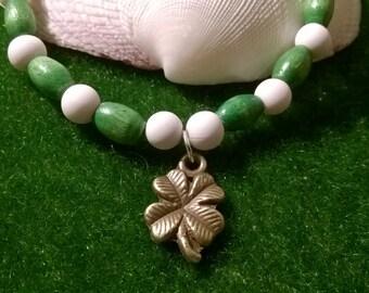 Charm bracelet~ green & white~ Bronze four leaf clover~ good luck charm~