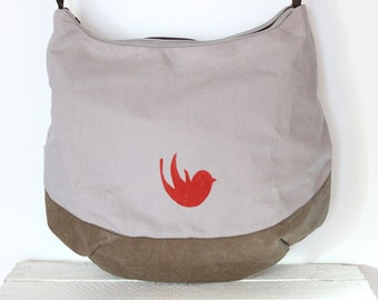 Large shoulder bag made of canvas and Snappap with red bird motif