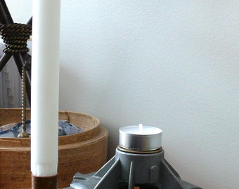 Industrial style candleholder makes a cover alternator and pieces of metal recovered