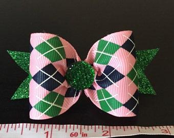 Pink argyle dog bow