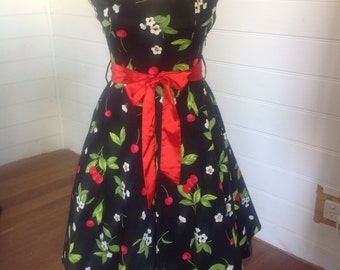 Vintage Retro style Rockabilly halter neck dress with red cherries and white flowers