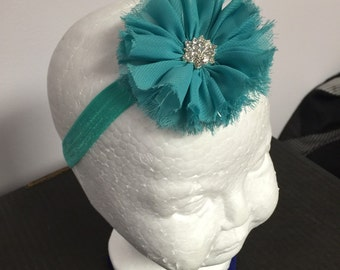 Teal flower headband with rhinestone centre