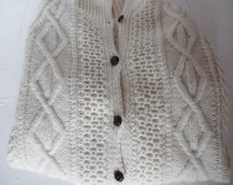 Traditional Arran cardigan sweater, hand knitted in cream with deep collar
