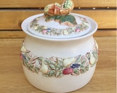 Stoneware canister with acorns, apples, pears, and grapes. Has a rubber seal to retain freshness.