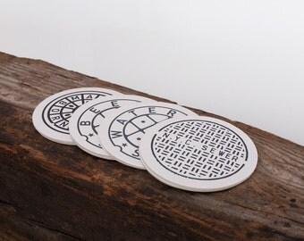 "Fun Coasters. Set of 8 ""Man Hole"" Letterpress Coasters. MANHATTAN BORN"
