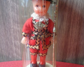 Vintage souvenir of London Beefeater doll in plastic tube
