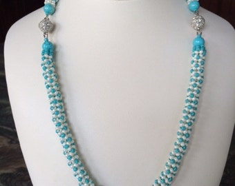 Tubular Chenille stitch necklace in turquoise and antique ivory pearl
