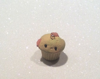 Polymer clay eaten alive cupcake!