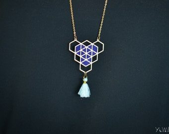 gold plated geometric necklace adorned with purple leather and blue pompon