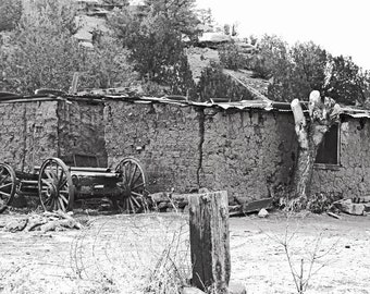 Old adobe shack and wagon, fine art photograph, black and white photography, landscape photo, antique adobe house