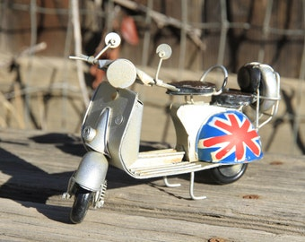 Vespa Motorcycle with English National Flag