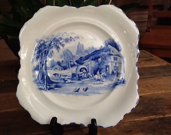 1920s vintage picture plate. Scalloped edges with pretty blue village pub scene