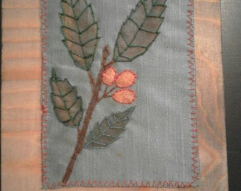Hand-embroidered botanical tables. Unique pieces