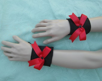 Black satin wristbands with red bows