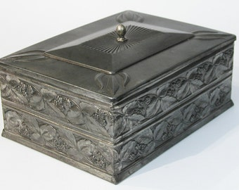 Vintage embossed tin box with a mirror inside the lid