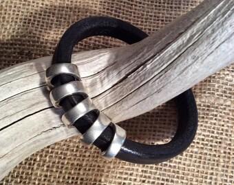 Black leather bracelet with bold antique silver slider