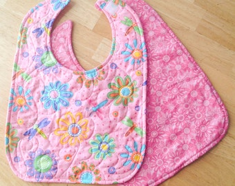 "quilted baby/toddler bib - pink flower print, velcro closure, reversible, 10"" x 13 1/2"""