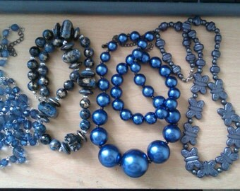 4 blue bead necklaces