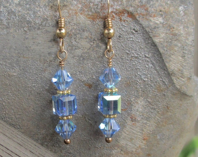 handmade delicate gold filled earrings with light blue Swarovski bicone and cube crystals on a gold filled ear wire