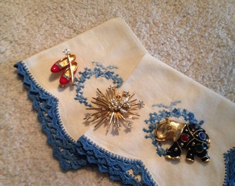 Lovely set of three pins with two embroidered handkerchiefs
