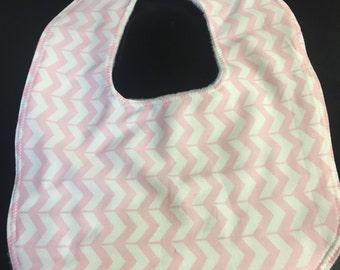 Pink and white baby bib