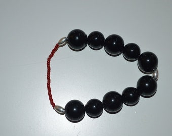 Black with silver and red accents stretch bracelet