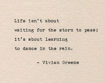 Vivian Greene on Dancing In The Rain literary quote hand typed on vintage typewriter