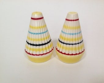 A 1960's striped salt and pepper ceramic cruet set.