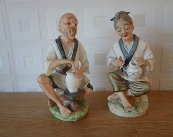 Old couple making vases