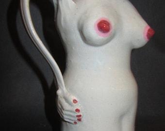 figurative pitcher vase
