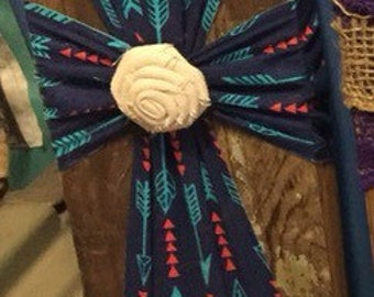Small burlap cross on old wood