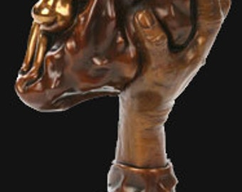 A Helping Hand. Bronze Hand Sculpture Holding Woman.