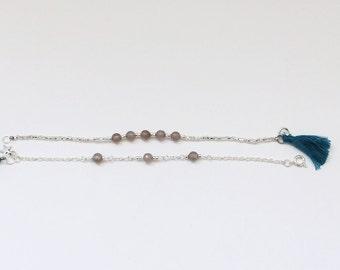 Double bracelet mini tassle