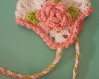 Baby hat with ear flaps and flower