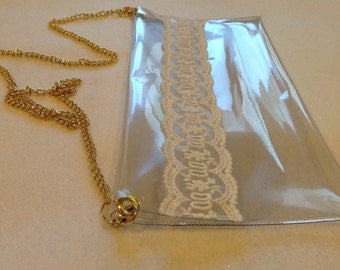 Elegant clear purse with lace design and removable gold chain strap