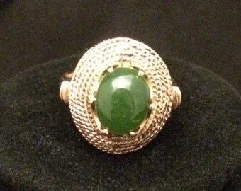 Elegant and bold, 10k gold with green jade center stone