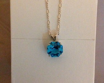 Hand cut Blue Laser Gem necklace