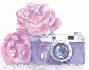 vintage photo camera with pink roses