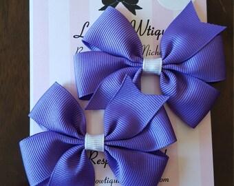 Pair of mini pinwheel bows