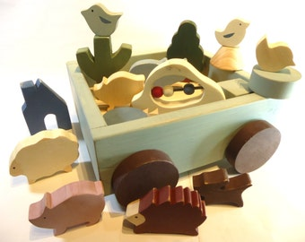 Wooden Animal Toys with a cart in the Japan style of vintage