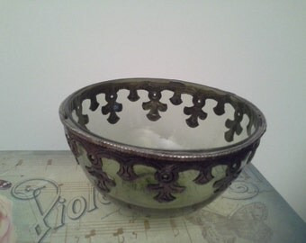 Green glass bowl with metal trim