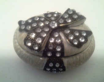 Metal and rhinestone trinket box, with bow
