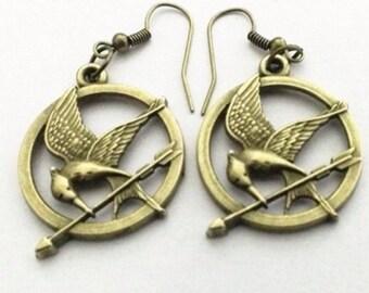 Earrings Sinsajo. The hunger games. Earrings Mockingjay The Hunger Games.