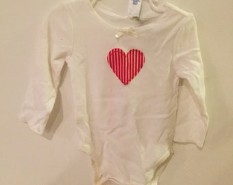 Baby onesie with applique heart