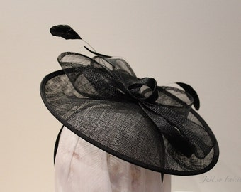 Black saucer fascinator with feathers and sinamay loops