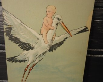 vintage postcard baby arriving on stork