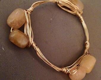 Tan blocks, gold wire