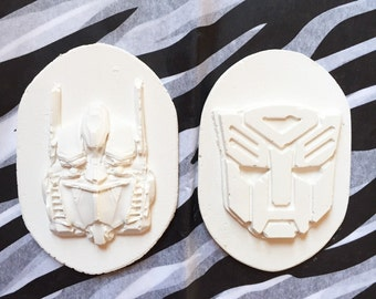 Transformers party favors. 2 differente transformers in separate gift bags. 2.99 each bag. Paintable with paint and brush.