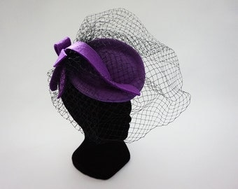 Cap with veil headpiece