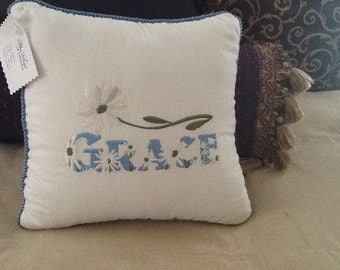 "Embroidered Pillow the word ""Grace"" with a Daisy."